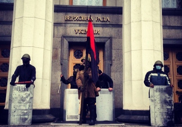 The flag of the wartime Ukrainian Insurgent Army, orginally allied with the Nazis, outside Ukraine's parliament building in a phot distributed by the fascist Right Sector