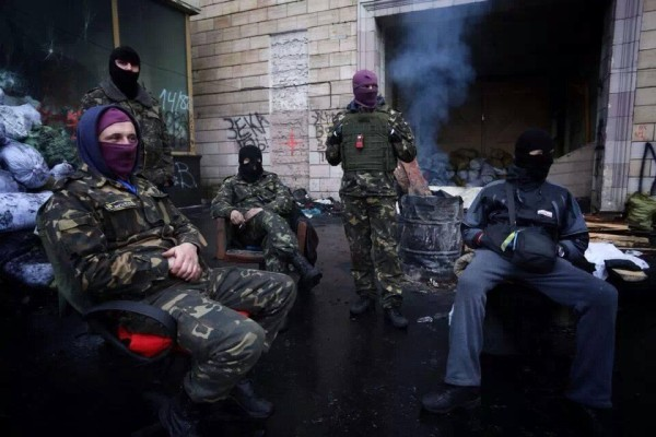 "Right Sector tweeted this, captioned: ""Future government"". That's the White Power Nazi 14/88 slogan behind them."
