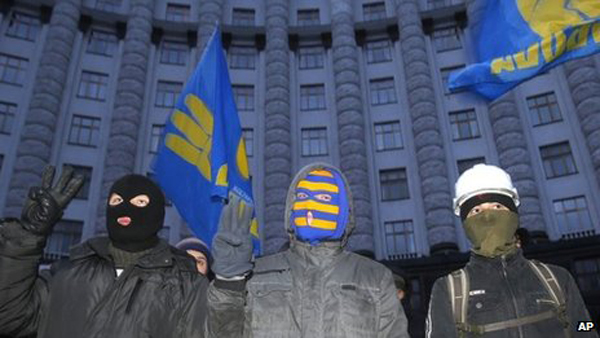 Not just protestors – those are the flags of the fascist Svoboda party. Pic credit: AP