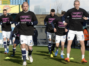 Warming up for Millwall's game against Brighton in Football v Homophobia tshirts. Pic credit: Millwall FC