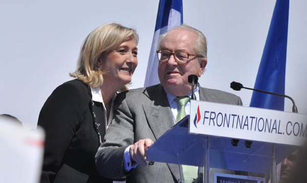 Fascist FN leader Marine Le Pen, with her father Jean Marie Le Pen, the party's founder and honorary president. Pic credit: Blandine Le Cain