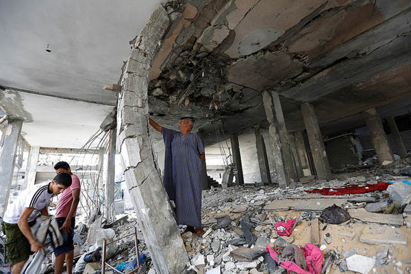 People lived here: a destroyed house in Gaza, on 22 July 2014. Pic credit: Mohammed Al Baba/Oxfam