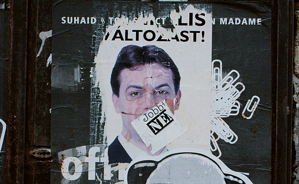 "A poster of Jobbik leader Gabor Vona has been decorated with a swastika and a ""Jobbik – NO"" sticker by antifascists. Pic credit: Habeebee"