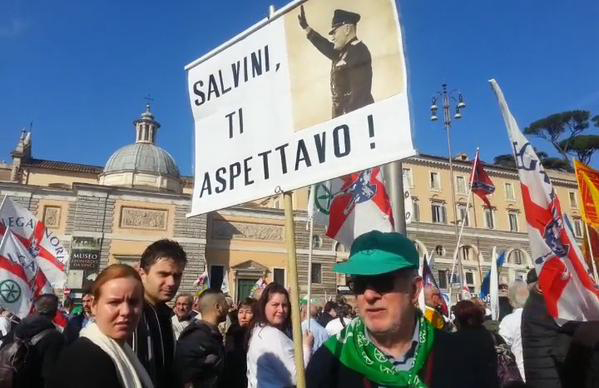 "Mussolini placard on display in Rome's Piazza del Popolo. The slogan reads: ""Salvini [Lega Nord leader], I  expect!"" Pic credit: Agenzia Dire"