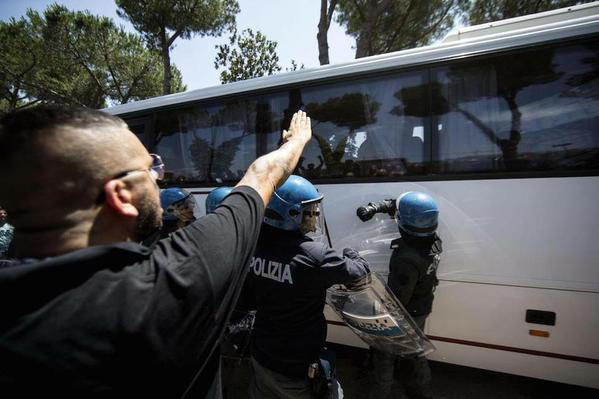 A fascist salute aimed at a bus carrying refugees in Rome