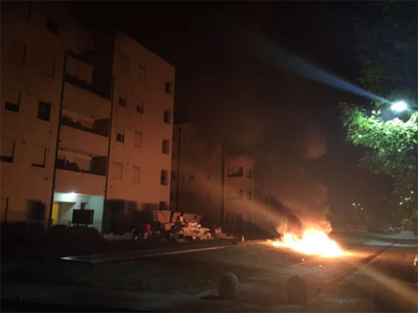 furniture, mattresses and belongings set on fire outside refugees' accommodation. Pic credit: Il Gazzettino