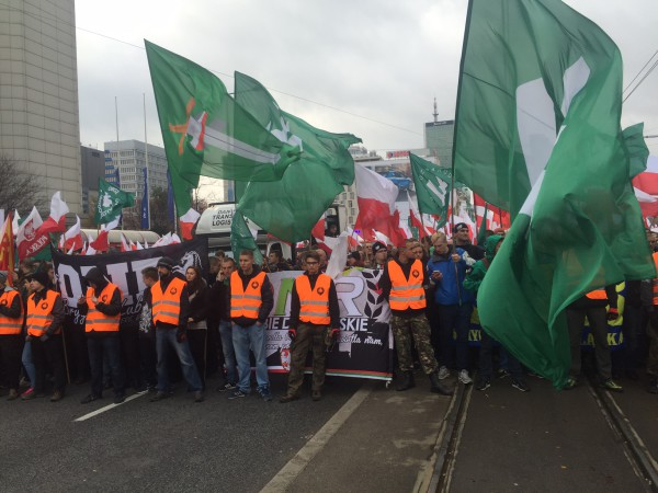 The green flags of Poland's two main fascist organisations at the start of the march