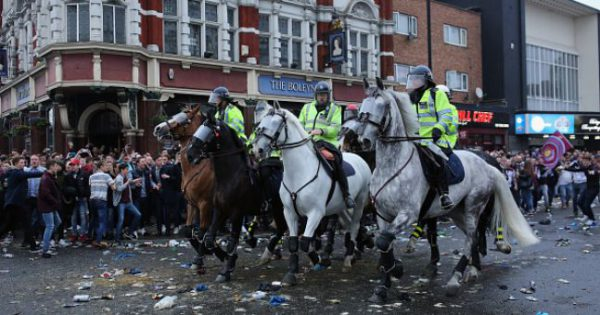 Police horse charge up Romford Road to clear the street!