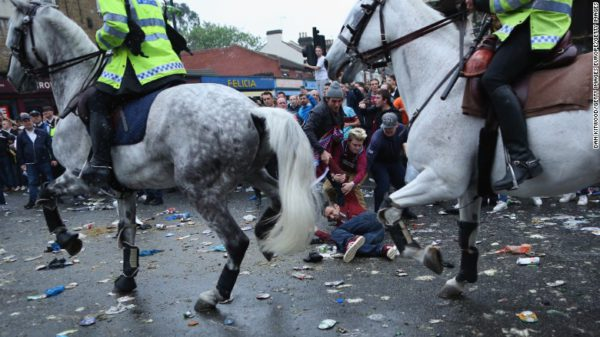 West Ham supporters protecting a fan from being trampled on by a police horse