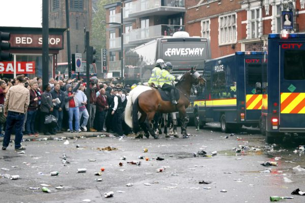 Police start forcing Man U coach up Green Street into thousands of people walking towards the ground